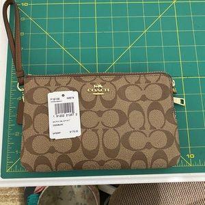Two tone brown larger sized wallet.